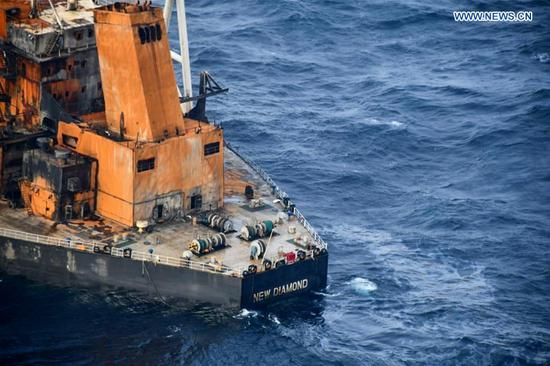 Photo taken on Sept. 9, 2020 shows the MT New Diamond oil tanker in the seas off Sri Lanka's eastern coast. The Sri Lanka Navy on Wednesday said a fire which had reignited onboard the MT New Diamond oil tanker on Monday has been brought under control and the distressed ship was being towed further away towards safe waters by a tug boat. (Sri Lanka Air Force Media/Handout via Xinhua)