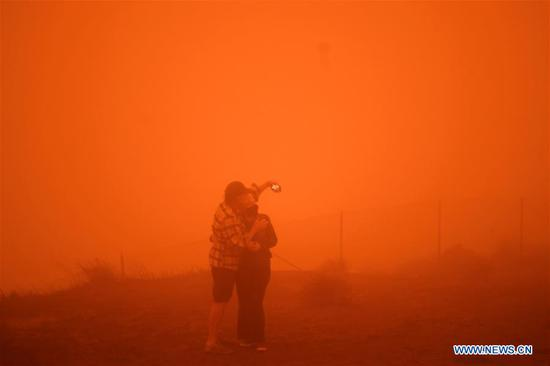 Photo taken on Sept. 9, 2020 shows the street view of the Chinatown at noon in San Francisco, the United States. San Francisco was still as dark as night at noon on Wednesday due to the wildfire. The Northern California wildfire has been burning for more than three weeks, forcing thousands to leave their homes and threatening other structures. (Xinhua/Wu Xiaoling)