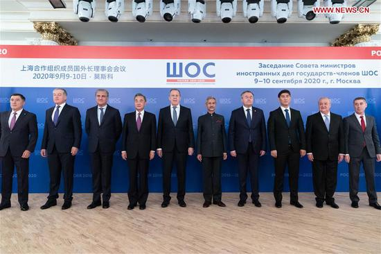 Chinese State Councilor and Foreign Minister Wang Yi (4th L) and other delegates pose for a photo ahead of a meeting of the Shanghai Cooperation Organization (SCO) Council of Foreign Ministers in Moscow, Russia, on Sept. 10, 2020. (Xinhua/Bai Xueqi)