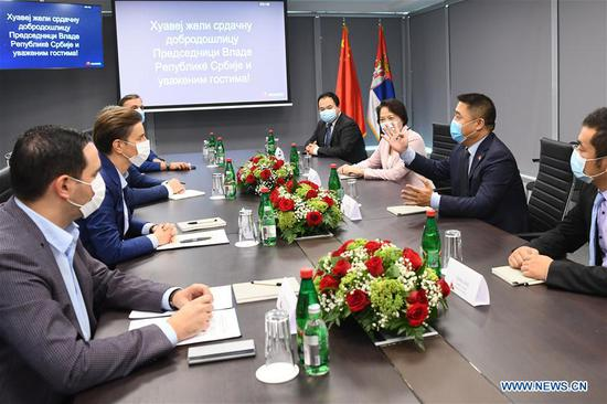 Serbian Prime Minister Ana Brnabic (2nd L) meets with Chinese Ambassador to Serbia Chen Bo (3rd R) and Li Mengqun (2nd R), president of Huawei Western Balkans, at Huawei's Innovations and Development Center in Belgrade, Serbia, on Sept. 14, 2020. Chinese tech giant Huawei opened its Innovations and Development Center here in the Serbian capital on Monday in the presence of Prime Minister Ana Brnabic, who sees it as an immense contribution to the digital transformation of the country's economy. (Huawei/Handout via Xinhua)