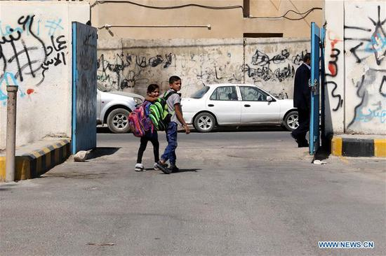 Students leave their schools in Baqa'a Palestinian refugee camp in Amman, Jordan, on Sept. 14, 2020. The Jordanian government on Monday announced its decision to suspend most of schools and close coffee shops, restaurants and mosques for two weeks starting Thursday amid a rise in coronavirus infections. On Monday, Jordan recorded two coronavirus-related deaths and 214 new cases, raising the death toll to 26 and the total tally in the kingdom to 3,528, according to Health Minister Saad Jaber. (Photo by Mohammad Abu Ghosh/Xinhua)