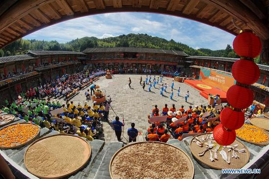People perform to celebrate bumper harvest during an event at Jiyang Village of Datian County, southeast China's Fujian Province, Sept. 20, 2020. Various activities are being held across the country to welcome the third Chinese farmers' harvest festival which falls on Sept. 22. (Photo by Lin Wenbin/Xinhua)