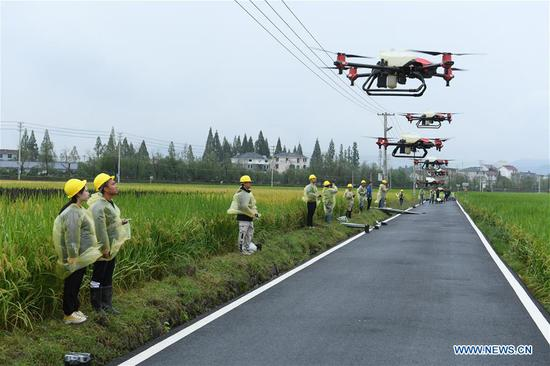 Drone controllers demonstrate operation of drones during an event celebrating the Chinese Farmers' Harvest Festival in Datong Town of Jiande City, east China's Zhejiang Province, Sept. 22, 2020. (Xinhua/Weng Xinyang)