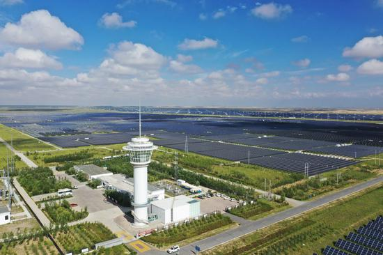 Aerial photo taken on Aug. 5, 2020 shows a photovoltaic power station at the green industrial development park in the Tibetan Autonomous Prefecture of Hainan, northwest China's Qinghai Province. (Xinhua/Xing Guangli)