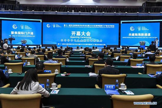 """People attend the opening ceremony of the 11th Pan-Beibu Gulf (PBG) Economic Cooperation Forum and the 2020 Beibu Gulf International Gateway Port Cooperation Summit in Nanning, capital of south China's Guangxi Zhuang Autonomous Region, Oct. 15, 2020. The theme of the event is """"Focusing on international gateway ports, jointly building a new international land-sea trade corridor."""" (Xinhua/Cao Yiming)"""