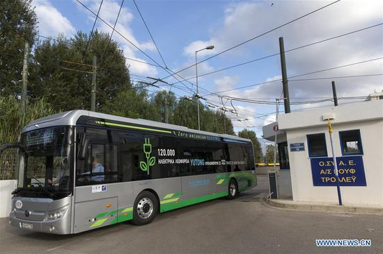 The electric bus Yutong U12 from China is seen starting its first route in Athens, Greece, Oct. 21, 2020. (Xinhua/Marios Lolos)