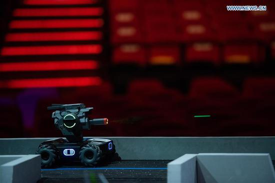 Photo taken on Oct. 21, 2020 shows a robot controlled by a contestant during the RoboMaster 2020 Youth Tournament in Macao, south China. A total of 18 teams from 10 middle schools participated in the robotics competition here on Wednesday. (Xinhua/Cheong Kam Ka)