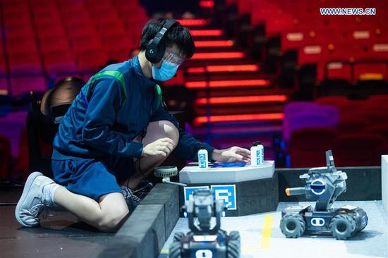 A contestant takes part in the RoboMaster 2020 Youth Tournament in Macao, south China on Oct. 21, 2020. A total of 18 teams from 10 middle schools participated in the robotics competition here on Wednesday. (Xinhua/Cheong Kam Ka)