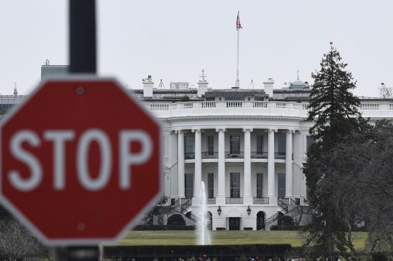 File photo shows the White House and a stop sign in Washington D.C., the United States. (Xinhua/Liu Jie)