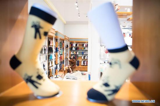 Photo taken on Oct. 27, 2020 shows exhibits at a sock company in Datang community of Zhuji, east China's Zhejiang Province. Sock companies in Datang, a major sock manufacturing base, began to see a rebound in business in the second half of the year. (Xinhua/Sadat)