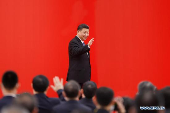 Chinese President Xi Jinping, also general secretary of the Communist Party of China Central Committee and chairman of the Central Military Commission, waves to people while attending a grand gathering that celebrates the 30th anniversary of the development and opening-up of Shanghai's Pudong in Shanghai, east China, Nov. 12, 2020. Xi delivered an important speech at the event. (Photo by Sheng Jiapeng/Xinhua)
