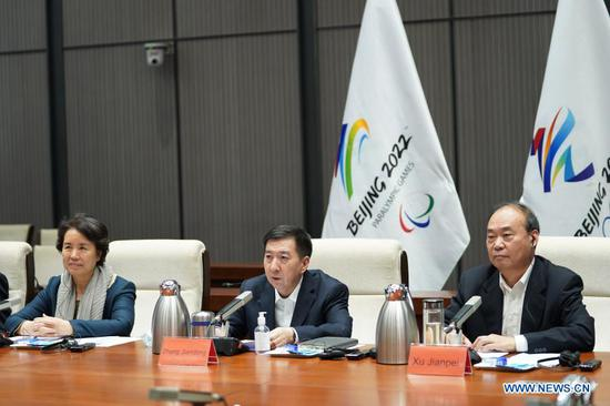 Zhang Jiandong (C), executive vice president of the Beijing Organizing Committee for the 2022 Olympic and Paralympic Winter Games (BOCOG), addresses the virtual International Olympic Committee (IOC) - International Paralympic Committee (IPC) Project Review for Beijing 2022 Olympic and Paralympic Winter Games in Beijing, capital of China, Nov. 19, 2020. The two-day meeting concluded on Friday with consensus reached in multiple areas between the IOC, the IPC and local organizers BOCOG. (Xinhua/Ju Huanzong)