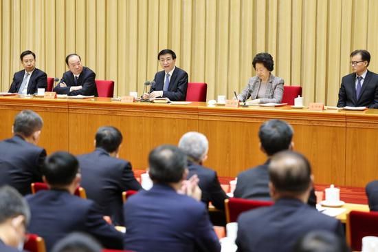 Wang Huning, a member of the Standing Committee of the Political Bureau of the Communist Party of China Central Committee and head of the Central Commission for Guiding Cultural and Ethical Progress, speaks at a ceremony to award representatives for their contributions to the cultural and ethical progress, in Beijing, capital of China, Nov. 20, 2020. (Xinhua/Liu Bin)