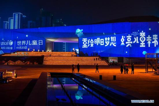 Buildings light up blue on the occasion of World Children's Day in the Changfeng commercial district of Taiyuan, north China's Shanxi Province, Nov. 20, 2020. Buildings and iconic monuments in some Chinese cities went blue on Friday to celebrate World Children's Day. World Children's Day is celebrated on November 20 each year to promote international togetherness, awareness among children worldwide, and improving children's welfare. (Xinhua/Cao Yang)