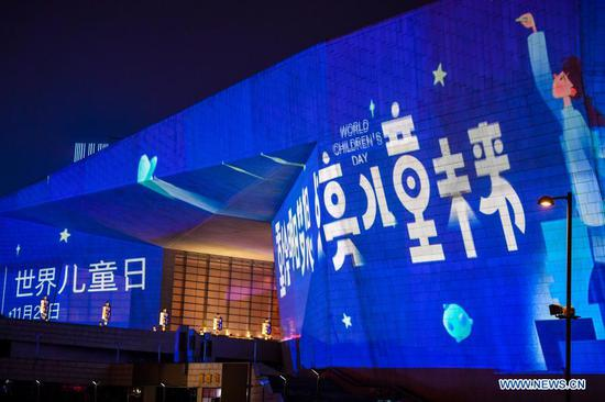 A building lights up blue on the occasion of World Children's Day in the Changfeng commercial district of Taiyuan, north China's Shanxi Province, Nov. 20, 2020. Buildings and iconic monuments in some Chinese cities went blue on Friday to celebrate World Children's Day. World Children's Day is celebrated on November 20 each year to promote international togetherness, awareness among children worldwide, and improving children's welfare. (Xinhua/Cao Yang)