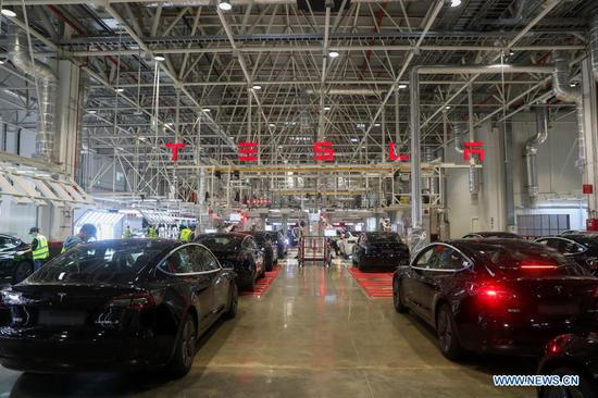 Photo taken on Nov. 20, 2020 shows the interior view of the Tesla Gigafactory in Shanghai, east China. U.S. electric car company Tesla in 2019 built its first Gigafactory outside the United States in the new Lingang area, with a designed annual production capacity of 500,000 units. The Tesla Shanghai Gigafactory broke ground in early 2019 and delivered its first batch of made-in-China Model 3 sedans one year later. With the second-phase project of its gigafactory under construction, Tesla expects to start the mass production of made-in-China Model Y vehicles in the first half of 2021. (Xinhua/Ding Ting)