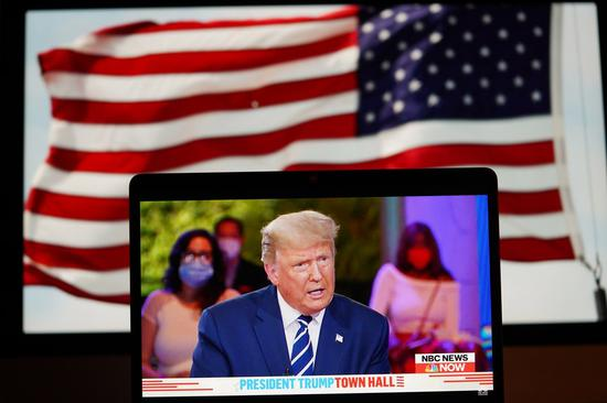 Photo taken in Arlington, Virginia, the United States, on Oct. 15, 2020 shows NBC live stream of U.S. President Donald Trump's town hall event outdoors in Miami, Florida. (Xinhua/Liu Jie)