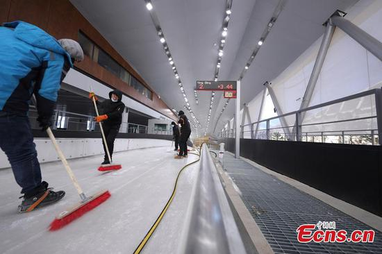 Workers clean the inside of the National Alpine Skiing Center in Yanqing, Beijing, Dec. 29, 2020. (Photo: China News Service/Jiang Qiming)