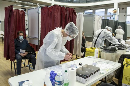 Medical workers wearing protective equipment are seen during a mass COVID-19 testing operation in Roubaix, northern France, Jan. 11, 2021. (Photo by Sebastien Courdji/Xinhua)