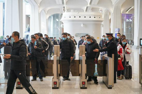 Passengers have their tickets checked at the Xiong'an Railway Station in Xiong'an New Area, north China's Hebei Province on Dec. 27, 2020. (Xinhua/Mu Yu)