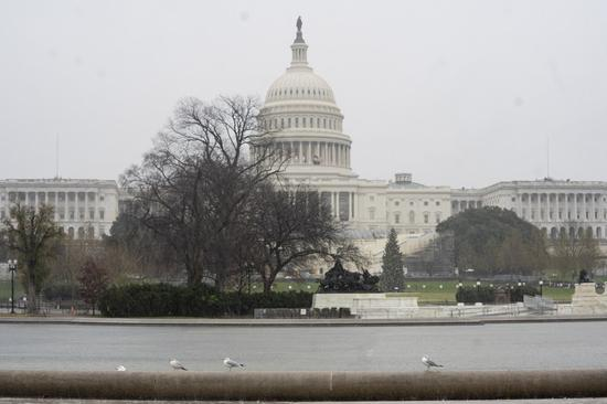 Photo taken on Dec. 14, 2020 shows the U.S. Capitol building in the rain in Washington, D.C., the United States. (Xinhua/Liu Jie)