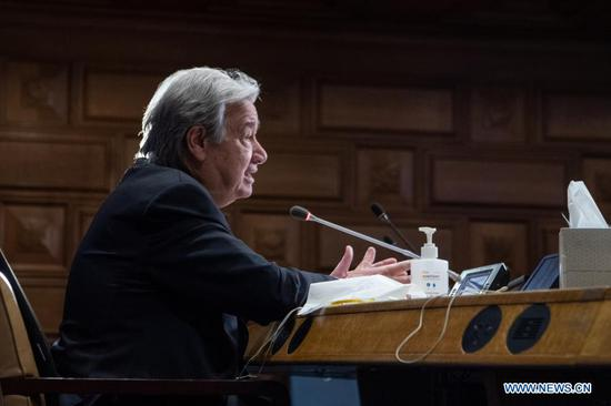 """United Nations Secretary-General Antonio Guterres attends a virtual briefing to update on preparations for COP26, at the UN headquarters in New York, on Feb. 8, 2021. Guterres on Monday told the member states that 2021 is a """"crucial year"""" for climate change. """"2021 is a crucial year in the fight against climate change,"""" the UN chief was speaking to a member states meeting as part of the preparations towards the latest annual UN climate conference, known as COP26, which will be held in Glasgow, Scotland, in November. Originally scheduled for last year, it had to be postponed due to the COVID-19 pandemic. (Eskinder Debebe/UN Photo/Handout via Xinhua)"""