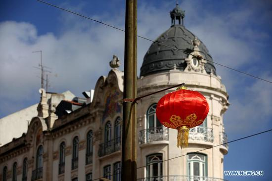 A red lantern set for Chinese Lunar New Year is seen at Almirante Reis avenue in Lisbon, Portugal, Feb. 12, 2021. The year 2021 is the Year of the Ox according to the Chinese zodiac. With Chinese culture and food becoming increasingly popular, people not only in China, but all over the world also take part in the Chinese New Year celebrations. (Photo by Pedro Fiuza/Xinhua)