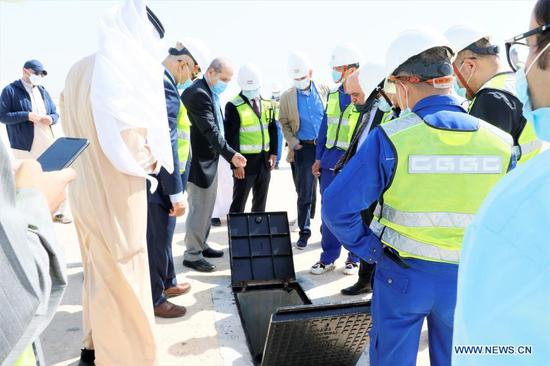 Representatives of China Gezhouba Group Corporation (CGGC) and the Kuwaiti side inspect the construction site of a CGGC project in a desert of Jahra Governorate, Kuwait, March 2, 2021. China Gezhouba Group Corporation (CGGC), affiliated to China Energy Engineering Group Co., Ltd., handed over on Tuesday the second batch of its housing infrastructure project to the Kuwaiti side, marking the handover of the main works of the project. (Photo by Liu Lianghaoyue/Xinhua)