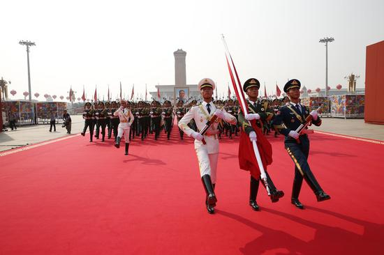 The national flag guards march from the Monument to the People's Heroes towards the national flag-raising post at the start of the celebrations for the 70th anniversary of the founding of the People's Republic of China in Beijing, capital of China, Oct. 1, 2019. (Xinhua/Fei Maohua)