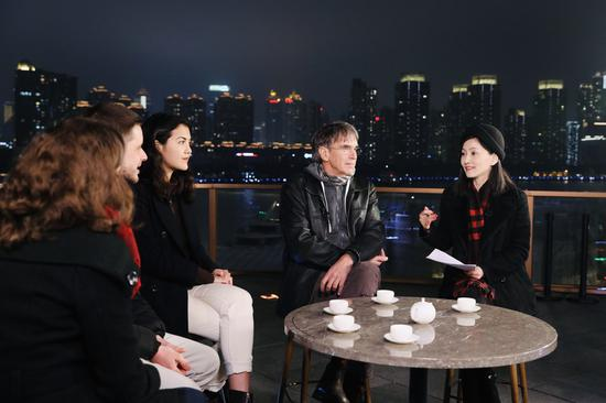 Four foreigners talk about their impressions on ordinary members of the Communist Party of China (CPC) with Xinhua journalist Miao Xiaojuan during the China Chat show in east China's Shanghai, Jan. 24, 2021. (Xinhua/Li Haiwei)