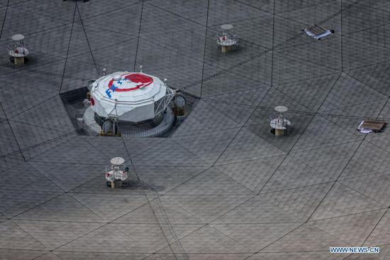 Photo taken on March 29, 2021 shows China's Five-hundred-meter Aperture Spherical radio Telescope (FAST) under maintenance in southwest China's Guizhou Province. FAST has identified over 300 pulsars so far. Located in a naturally deep and round karst depression in southwest China's Guizhou Province, it officially began operating on Jan. 11, 2020. (Xinhua/Ou Dongqu)
