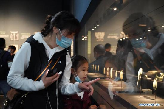 People visit the Sanxingdui Museum in Guanghan City, southwest China's Sichuan Province on April 4, 2021. The major discoveries made recently by archaeologists at the legendary Sanxingdui Ruins site in Sichuan have triggered wide interest among the general public in China, and many of them chose to visit the Sanxingdui Museum during the three-day Qingming holiday. (Xinhua/Liu Mengqi)