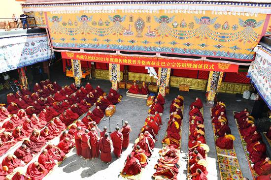 Monks attend the debate activity, a part of the award ceremony of the degree of Geshe Lharampa held in the Jokhang Temple in Lhasa, capital of southwest China's Tibet Autonomous Region, April 5, 2021. (Xinhua/Sun Ruibo)