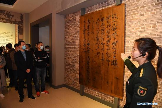 A guide introduces the life story of Fang Zhimin, a revolutionary martyr who died in 1935, in Nanchang, capital of east China's Jiangxi Province, April 7, 2021. (Xinhua/Zhou Mi)