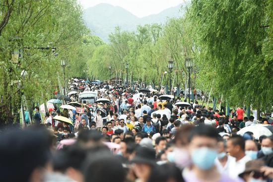 West Lake in Hangzhou, Zhejiang Province, is packed with tourists on May 1, 2021.