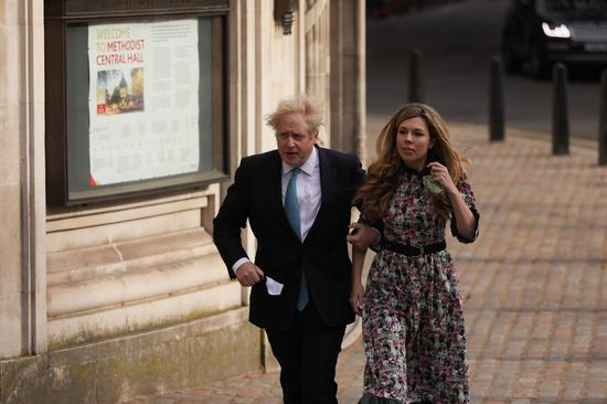 Britain's Prime Minister Boris Johnson and his fiancee Carrie Symonds arrive to vote for the local elections at a polling station in London, Britain, May 6, 2021. (Photo by Tim Ireland/Xinhua)