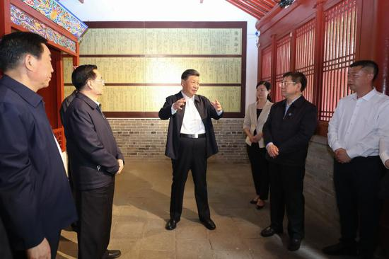 Chinese President Xi Jinping, also general secretary of the Communist Party of China Central Committee and chairman of the Central Military Commission, visits a memorial facility dedicated to Zhang Zhongjing, a famous Chinese pharmacologist and physician of the Eastern Han Dynasty (25-220), in Nanyang, central China's Henan Province, May 12, 2021. Xi learned about Zhang's life story and his contributions to the development of traditional Chinese medicine. Xi Jinping on Wednesday inspected the city of Nanyang in Henan Province. (Xinhua/Wang Ye)