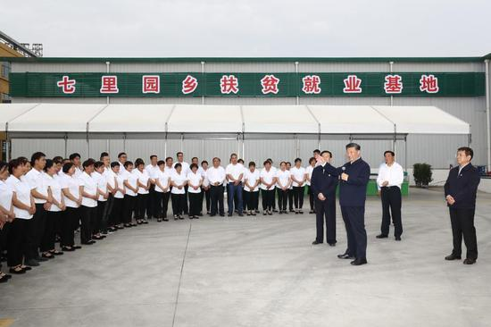 Chinese President Xi Jinping, also general secretary of the Communist Party of China Central Committee and chairman of the Central Military Commission, talks with employees of a local company producing mugwort products in Nanyang, central China's Henan Province, May 12, 2021. Xi Jinping on Wednesday inspected the city of Nanyang in Henan Province. (Xinhua/Ju Peng)