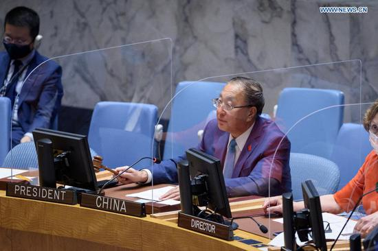 Zhang Jun, China's permanent representative to the United Nations and rotating president of the UN Security Council for May, presides over a meeting of the Security Council at the UN headquarters in New York May 27, 2021.  (Loey Felipe/UN Photo/Handout via Xinhua)