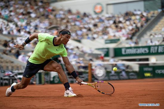 Rafael Nadal of Spain hits a return during the men's singles quarterfinal against Diego Schwartzman of Argentina at the French Open tennis tournament at Roland Garros in Paris, France, June 9, 2021. (Photo by Aurelien Morissard/Xinhua)