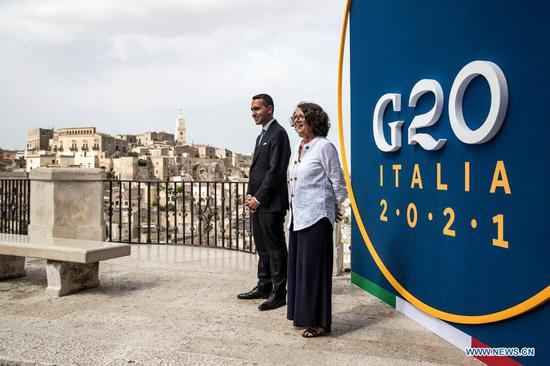 """Italian Foreign Minister Luigi Di Maio (L) and Italian Deputy Minister for Foreign Affairs and International Cooperation Marina Sereni welcome participants for the meeting of the Group of 20 (G20) ministers of foreign affairs and development in Matera, Italy, on June 29, 2021. Ministers of foreign affairs and development from the world's 20 biggest economies on Tuesday called on the entire international community to build inclusive and resilient food chains, to ensure adequate nutrition for all, in line with the goal of """"Zero Hunger"""" set for 2030. (Angelo Carconi/ANSA/Handout via Xinhua)"""