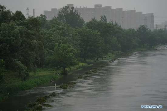 Hiking trails are flooded during a rainfall near Liangshui River in Daxing District of Beijing, capital of China, July 12, 2021. Heavy rainstorm has lashed the Chinese capital Beijing since 6 p.m. Sunday with precipitation up to 116.4 mm, according to the municipal flood control department. From 6 p.m. Sunday to 9 a.m. Monday, Beijing registered average rainfall of 65.9 mm. Urban areas of the city reported higher average precipitation of 79.9 mm. (Xinhua/Peng Ziyang)