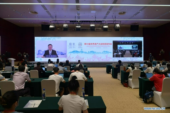 Tian Xuejun, Chinese vice education minister, director of the Chinese National Commission for UNESCO and chairperson of the World Heritage Committee's 44th session, speaks via video link during a video press conference of the 44th session of the World Heritage Committee on July 18, 2021. (Xinhua)