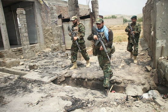 Afghan security force members take part in a military operation against Taliban militants in Alishing district of Laghman province, eastern Afghanistan, on July 12, 2021. (Photo by Saifurahman Safi/Xinhua)