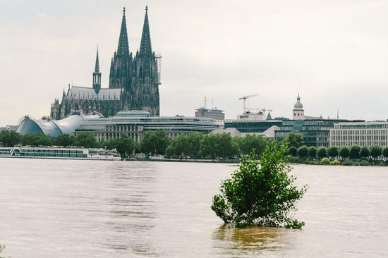 The bank of the river Rhine is seen flooded in Cologne, western Germany, July 15, 2021. (Photo by Tang Ying/Xinhua)