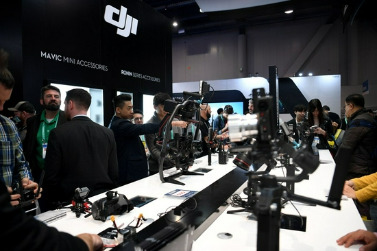 People visit Chinese drone maker DJI's booth at the 2020 Consumer Electronics Show (CES) in Las Vegas, the United States, Jan. 8, 2020. (Xinhua/Wu Xiaoling)