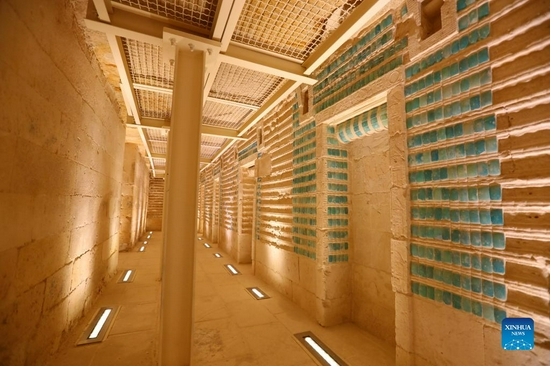 Photo shows the interior of the south tomb of King Djoser in Saqqara necropolis, south of Cairo, Egypt, on Sept. 14, 2021. Egypt on Monday opened the south tomb of King Djoser after restoration in Saqqara necropolis near the capital Cairo. The restoration process started in 2006 and involved conservation and restoration work of the lower corridors, strengthening the walls and ceilings, complete the interior inscriptions in the tomb as reassembling the granite sarcophagus. (Xinhua/Sui Xiankai)