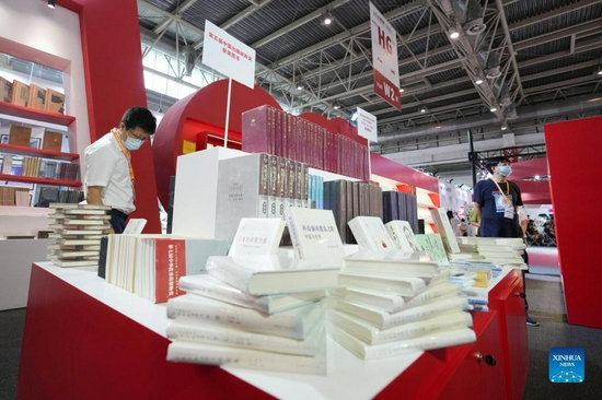 People visit the 28th Beijing International Book Fair in Beijing, capital of China, Sept. 14, 2021. The book fair kicked off Tuesday and is scheduled until Sept. 18. It has attracted roughly 2,200 exhibitors from 105 countries and regions, including 57 along the Belt and Road, said the organizer, adding that over 300,000 books are on display. (Xinhua/Ju Huanzong)