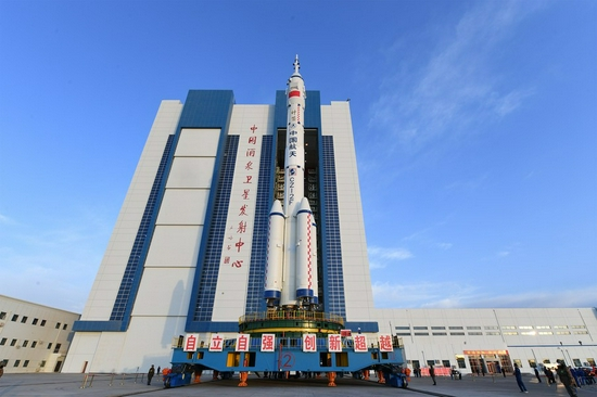The combination of the Shenzhou-13 manned spaceship and a Long March-2F carrier rocket prepares to be transferred to the launching area of Jiuquan Satellite Launch Center in northwest China, Oct. 7, 2021. (Photo by Wang Jiangbo/Xinhua)