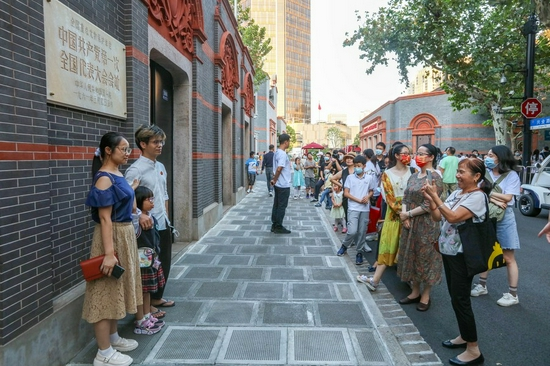 Tourists take photos at the site of the first National Congress of the Communist Party of China (CPC) in east China's Shanghai, Oct. 3, 2021. (Xinhua/Wang Xiang)